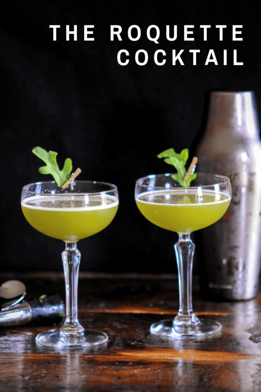 Green cocktails in coupes with leaves pinned to glasses. Shaker behind