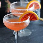 Orange cocktails in coupes with blood orange slices