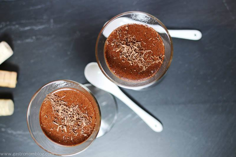 Chocolate Pot de Creme in glasses, white spoons on a slate board