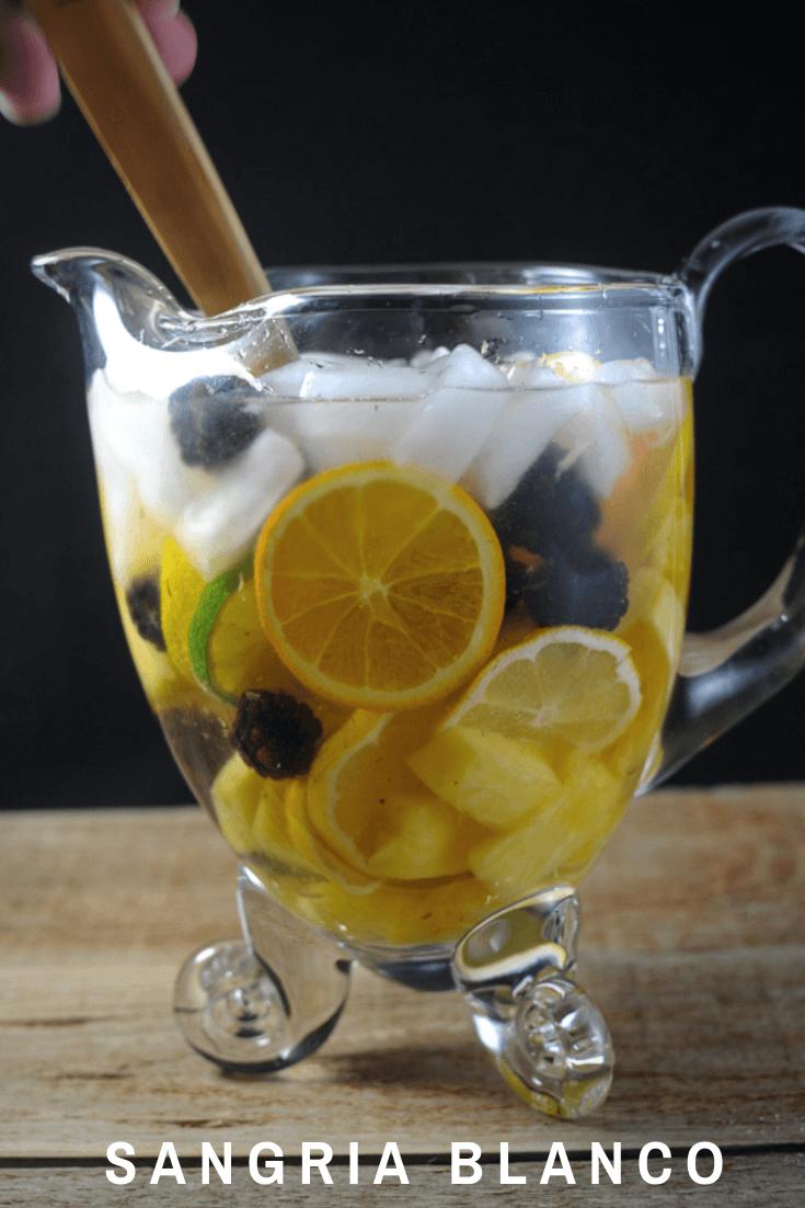 Sangria Blanca with orange liqueur and a dry white wine. Limes, lemons, pineapple, oranges and blackberries from Gastronomblog. #wine #drink #lime #lemon #gastronomblog