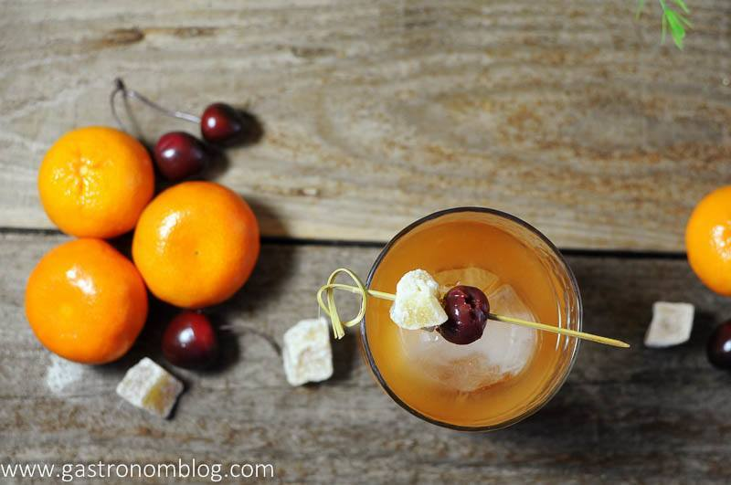 Ginger Clementine Old Fashioned Cocktail with candied ginger, cherries and clementines. Ginger Old Fashioned.