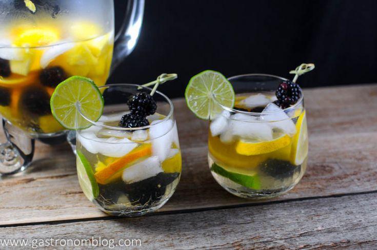 Sangria Blanca with orange liqueur and a dry white wine. Limes, lemons, pineapple, oranges and blackberries. #wine #drink #lime #lemon #gastronomblog