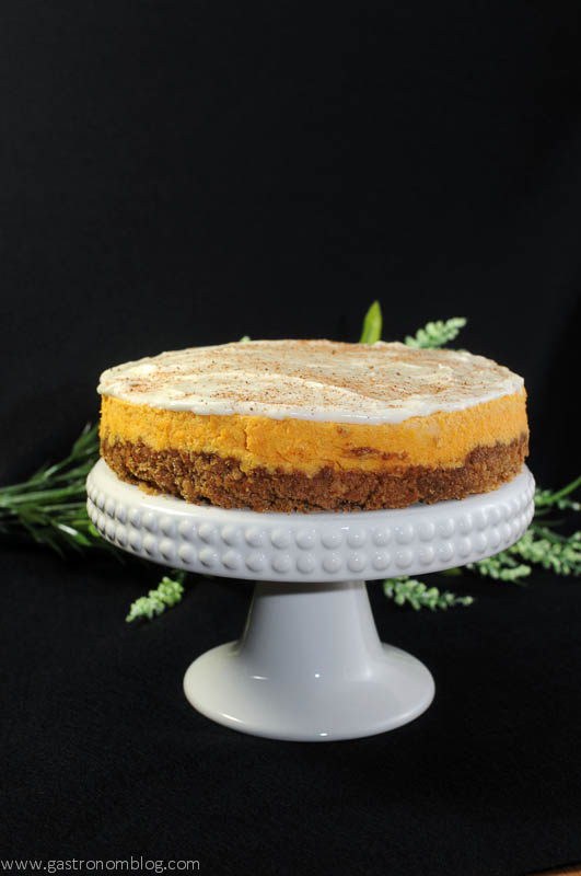 Carrot Cheesecake on a white pedestal plate