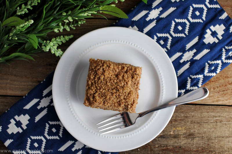 Streusel Topped Coffee Cake on a white plate, blue/white napkin under