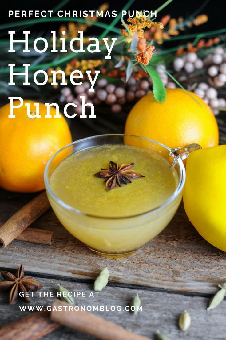 Holiday Honey Punch - honey spice simple syrup, whiskey, orange juice, lemon juice, prosecco, orange bitters. Makes a great Christmas punch bowl for parties from Gastronomblog! This Christmas champagne punch is sparkling and spiked, so easy and delicous! #holiday #christmas #cocktail #gastronomblog #whiskey