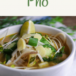Crockpot Chicken Pho - in a white bowl, topped with jalapenos and lime slices