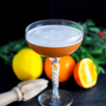 orange cocktail with white foam