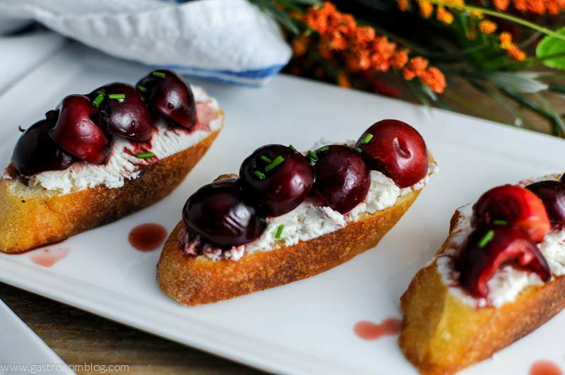 Cherry Goat Cheese Crostini on a white plate