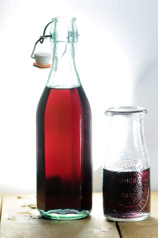 Hibiscus Simple Syrup in a bottle