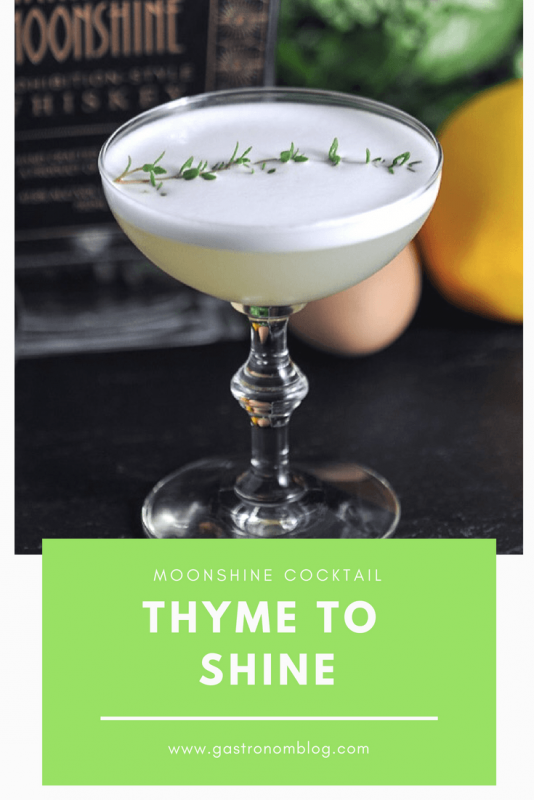 Thyme to Shine cocktail in coupe with thyme leaves and flowers, eggs and bottle behind