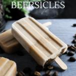 Tan popsicles on slate board, coffee beans
