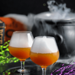 Cocktails in bulb glasses with dry ice, Halloween decor