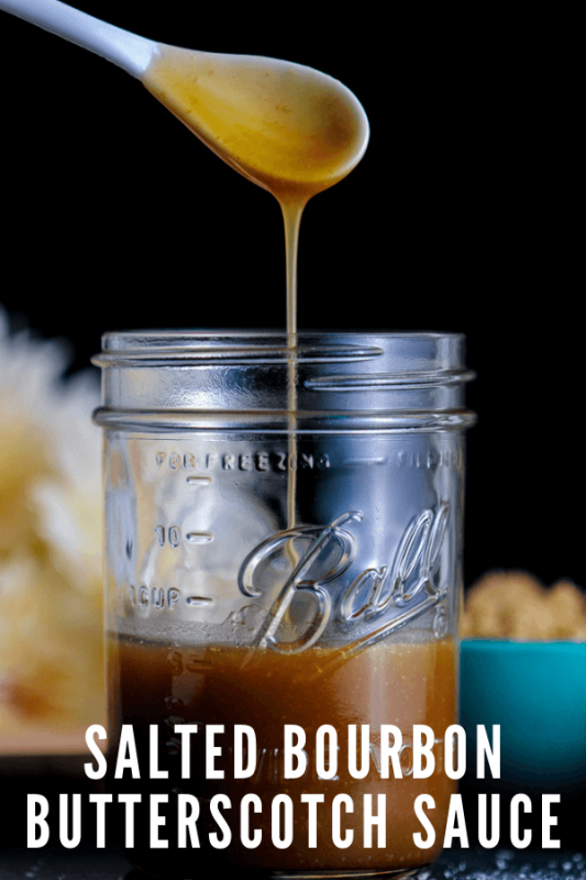 Butterscotch being drizzled into a jar from a spoon