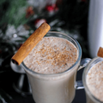 Eggnog in mugs with cinnamon Stick