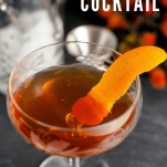 whiskey cocktail in coupe with orange peel