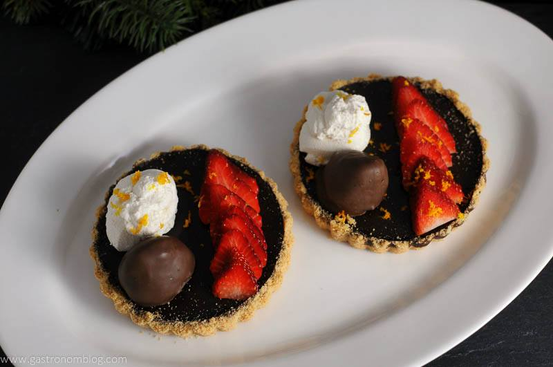 Chocolate Bourbon Tart with Strawberries on white plate