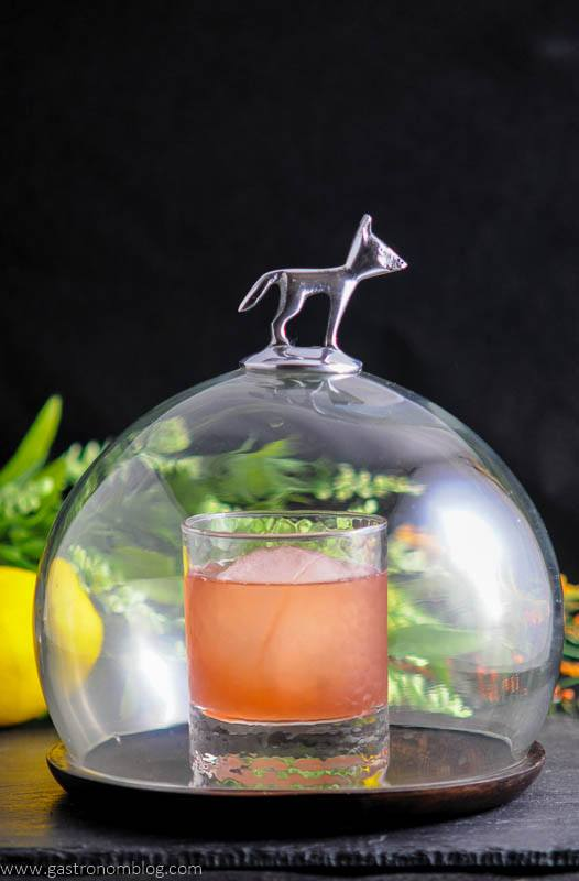 The Smoked Cherry cocktail under cloche for smoking. Silver fox on top.