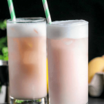 Pink highball cocktail with white foam