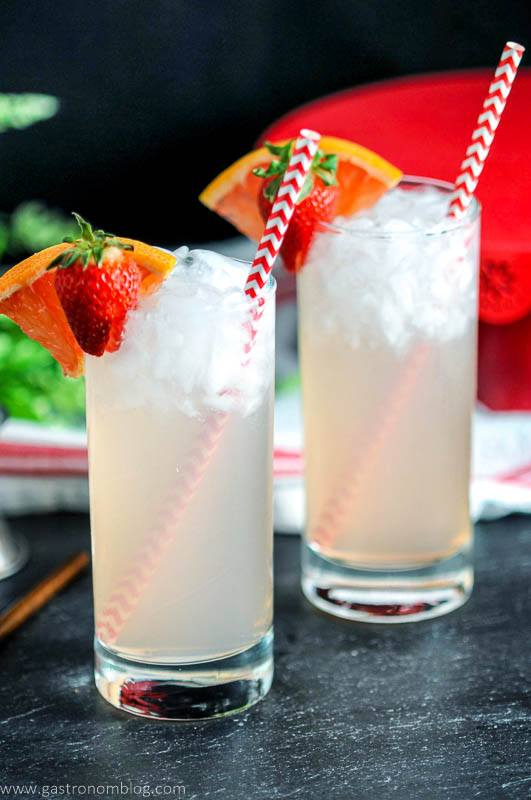 Strawberry Paloma cocktail in highballs glasses. Strawberry, grapefruit wedge and straws
