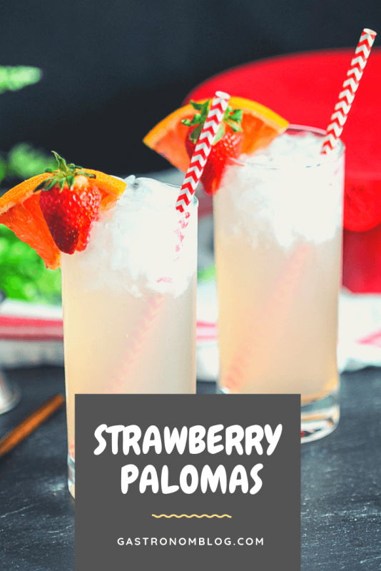 Strawberry Paloma Cocktails in tall glasses with strawberries and oranges, red and white striped straws