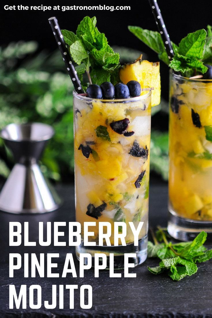 Blueberry Pineapple Mojito - rum, pineapple, blueberries, lime juice, mint simple syrup, club soda. A taste of the tropics from Gastronomblog. #cocktails #mojito #blueberries #pineapple #gastronomblog