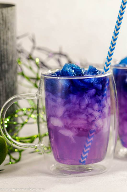 Galaxy Magic Moscow Mule in clear glass mug with blue straw. Color changing cocktail