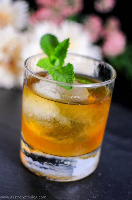 Apricot Honey Bourbon Sour Cocktail in rocks glass with mint leaves