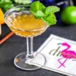 Orange cocktail with mint, flamingo napkin