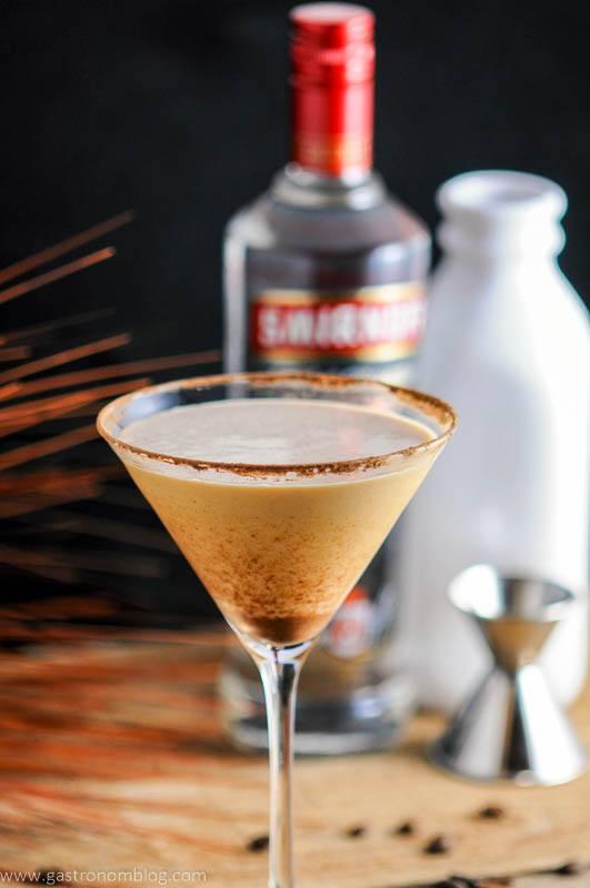 Prettay Prettay Prettay Good Latte Martini with Smirnoff Vokda in martini glass. Vodka bottle, jigger and milk bottle in background