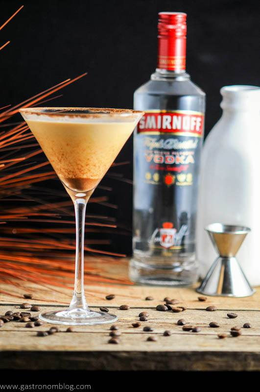 Prettay Prettay Prettay Good Latte Martini with Smirnoff Vokda in martini glass. Jigger, vodka bottle and milk bottle in background