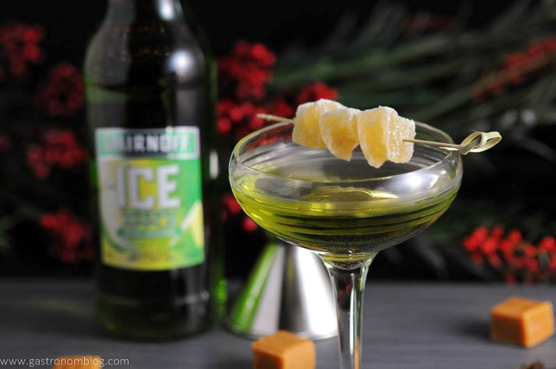 Caramel Green Apple in cocktail coupe with candied ginger. Smirnoff Green Apple bottle in background