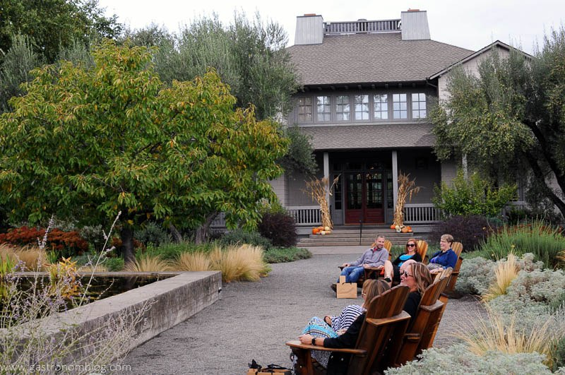 Group of friends enjoy the grounds and gardens at Frog's Leap Winery in Napa Valley
