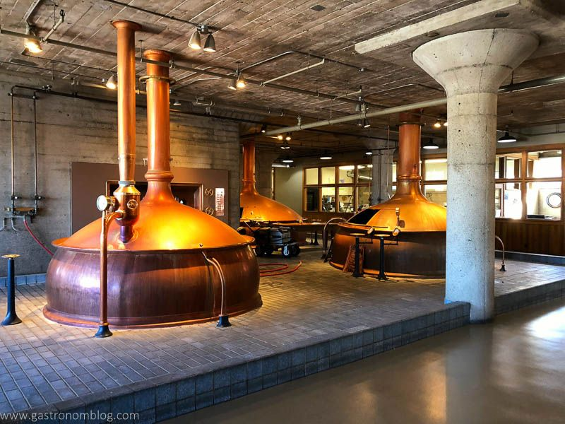 Big copper pot stills sit in the main distilling room of Anchor Distilling