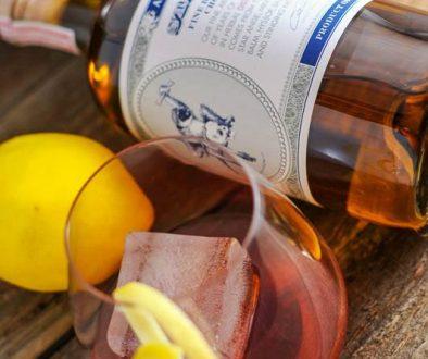A blackberry sazerac cocktail featuring St George Spirits Absinthe Verde sits ready to drink.