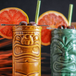 Tiki mugs with straws and grapefruit wheels
