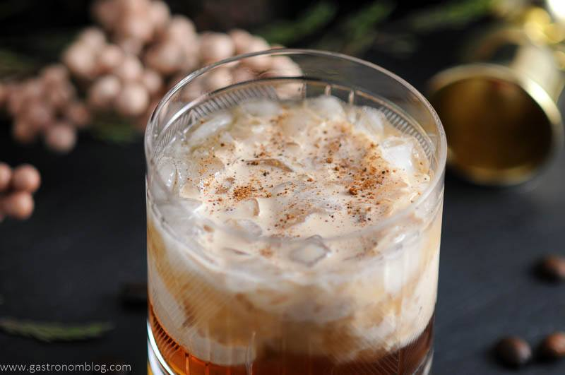 Toasted cream floats on top of a mixture of Kahlua, vodka and chai tea simple syrup, making a Chai Toasted Cream White Russian Cocktail.