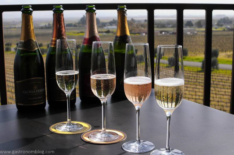 Four champange flutes filled with varieties of Gloria Ferrer Sparkling wine.