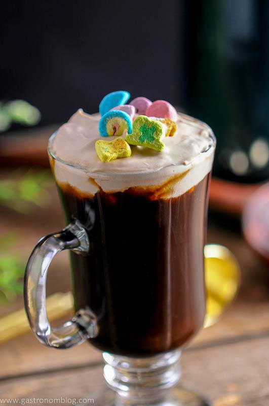 A mug of Toasted Cream Irish Coffee garnished with Lucky Charm's Marshmallow