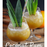 Cocktails in glasses with pineapple fronds