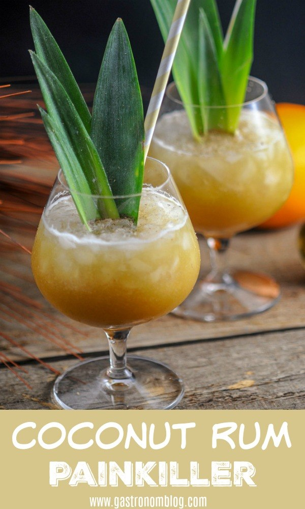 Coconut Rum Painkiller Cocktail with coconut rum, dark rum, pineapple juice, orange juice, allspice dram and a dash of nutmeg. #cocktail #rum #coconut #pineapple #gastronomblog