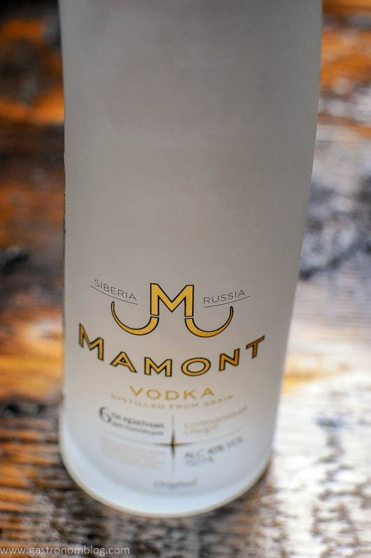 Detailed shot of the Mamont Vodka logo displayed on Mamont Vodka's distinictive Mammoth Tusk inspired bottle.