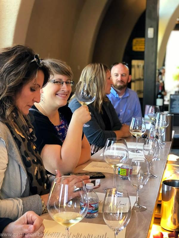 Friends enjoying wine tasting at the bar of Fritz Underground Winery in Sonoma County, Claifornia.
