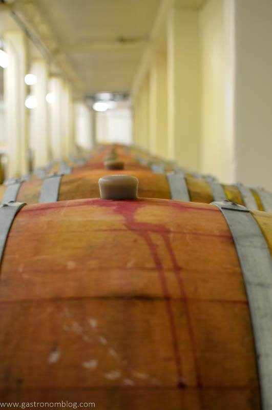 Wine barrels filled with red wine are aged in the underground caves at Fritz Underground Winery.
