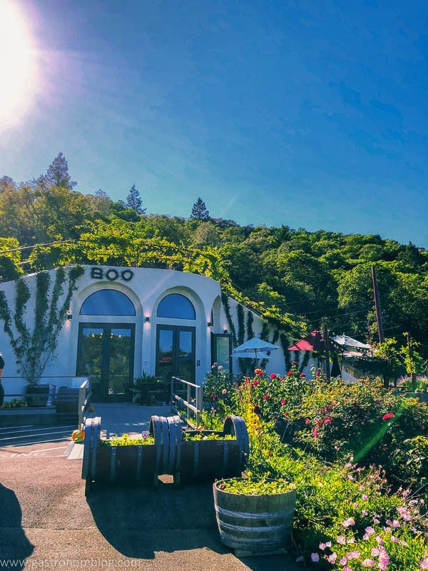 The tasting room of Fritz Underground Winery built into a hill is surrounded with flowers and a picnic area.