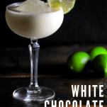 White cocktail in a coupe with a lime wheel