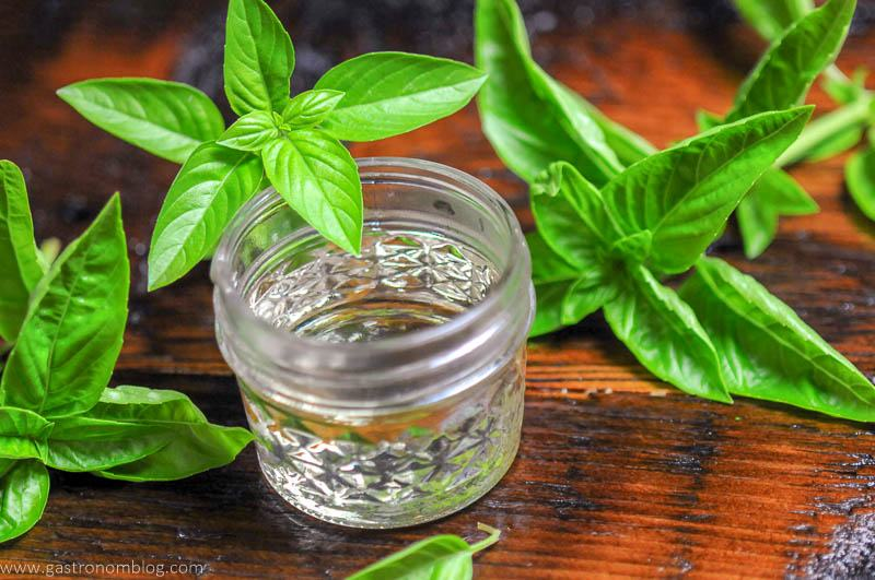 syrup in jar with basil sprigs
