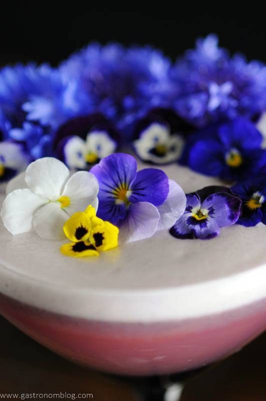 Edible flowers on top of egg white foam cocktail