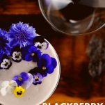 Top view of an egg white cocktail with edible flowers