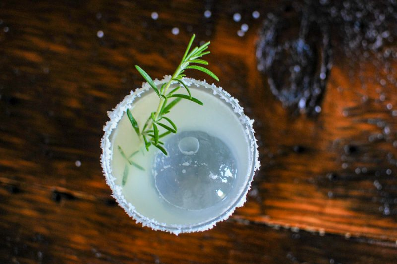 Top shot of margarita with salt rim and rosemary