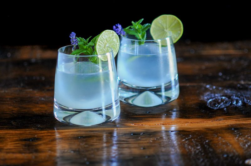 Cocktails with lime wheels, mint and lavender